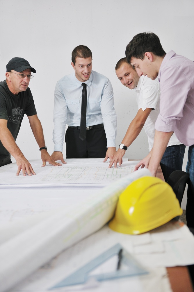 Team of business people in group, architect and engeneer  on construciton site check documents and business workflow on new building.jpeg